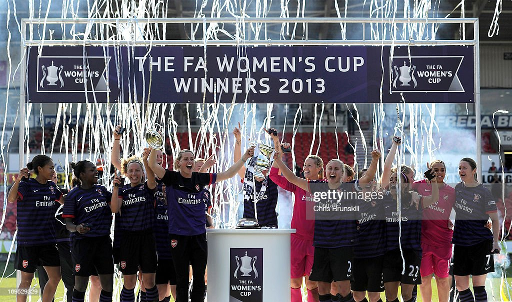 Arsenal Ladies FC player Kelly Smith (L) lifts the trophy with captain Stephanie Houghton following the The FA Women's Cup Final between Bristol Academy Women's FC and Arsenal Ladies FC at Keepmoat Stadium on May 26, 2013 in Doncaster, England.