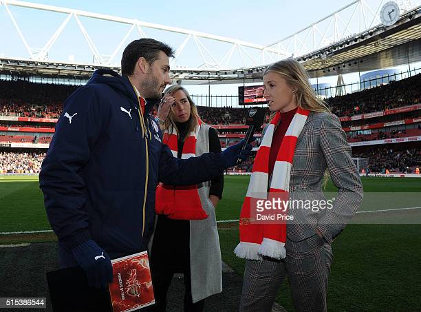 Arsenal Ladies Jordan Nobbs and Leah Williamson are interviewed by Nigel Mitchell during half time of the match between Arsenal and Watford in the FA...