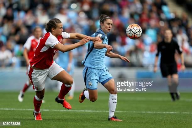 Arsenal Ladies Josephine Henning and Manchester City's Jane Ross challenge