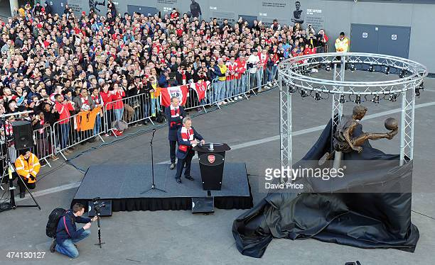 Arsenal Legend Dennis Bergkamp and Arsenal director Ken Friar unveil a statue outside the stadium in Bergkamp's honour before the match between...