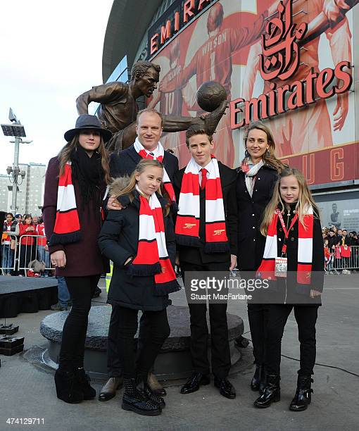 Arsenal legend Dennis Bergkamp and his family at the unveiling of a statue in his honour before the Barclays Premier League match between Arsenal and...