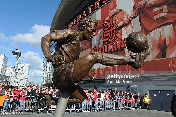 Arsenal legend Dennis Bergkamp's statue unveiled before the Barclays Premier League match between Arsenal and Sunderland at Emirates Stadium on...