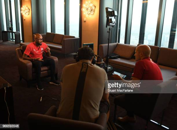 Arsenal Legend Niclas Anelka conducts an interview in the team hotel before the match between Real Madrid CL Legends and Arsenal FC Legends at...