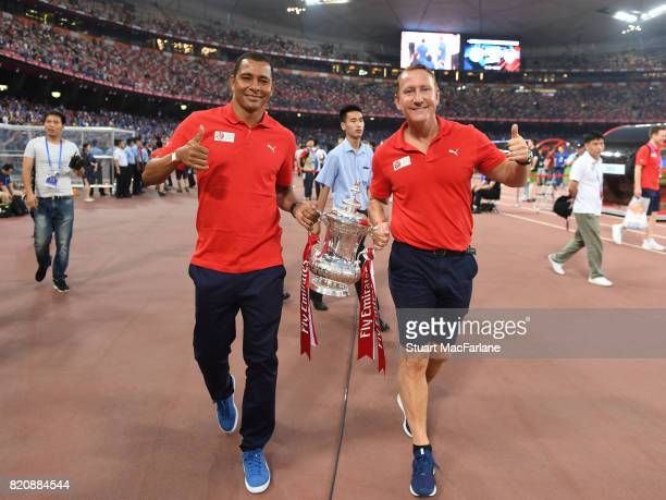 Arsenal legends Gilberto and Ray Parlour parade the FA Cup before the pre season friendly between Arsenal and Chelsea at the Birds Nest on July 22...