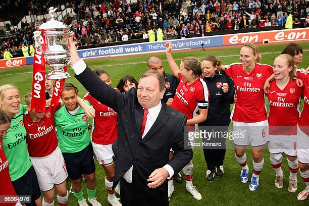 Arsenal LFC manager Vic Akers holds the trophy aloft as players celebrate victory after the FA Women's Cup Final Sponsored by EON against Sunderland...