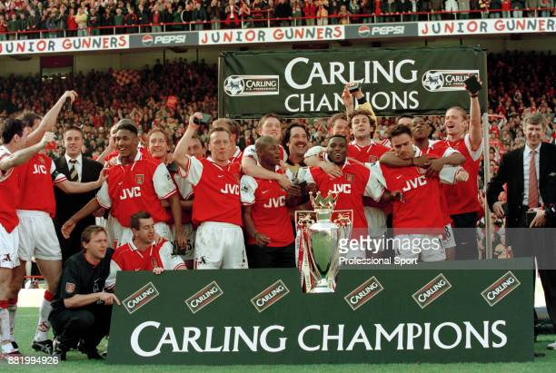 Arsenal line up for a group photo after the final home game of the season at Highbury in which they became FA Carling Premiership champions on May 03...