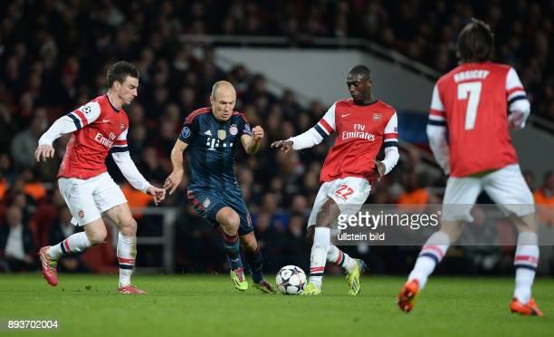 FUSSBALL CHAMPIONS Arsenal London FC Bayern Muenchen Arjen Robben gegen Laurent Koscielny und Yaya Sanogo