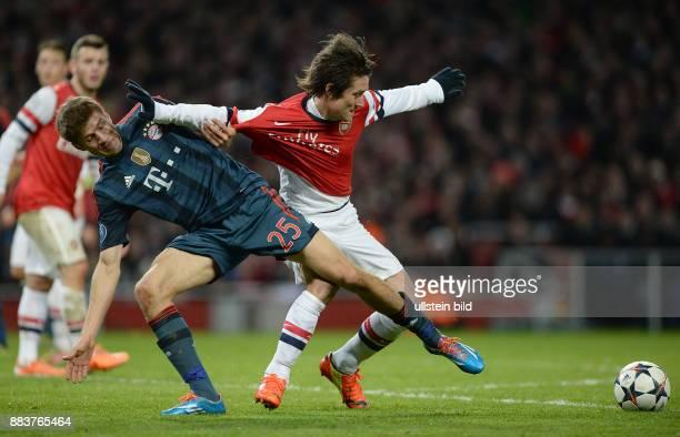 FUSSBALL CHAMPIONS Arsenal London FC Bayern Muenchen Thomas Mueller gegen Tomas Rosicky