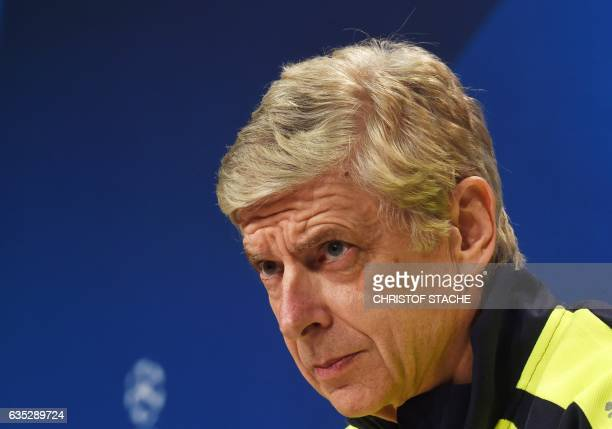 Arsenal London's French headcoach Arsene Wenger follows the press conference at the stadium in Munich southern Germany on February 14 on the eve of...