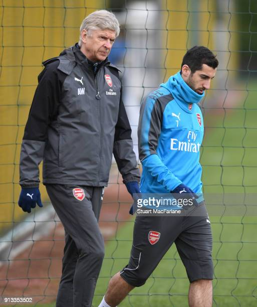 Arsenal manager Arseen Wenger with Henrikh Mkhitaryan during a training session at London Colney on February 2 2018 in St Albans England