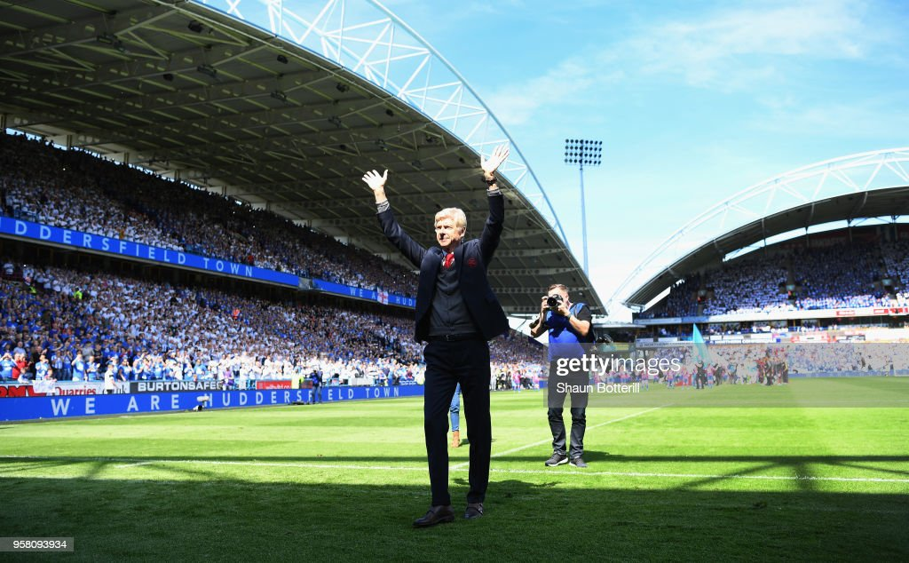 Arsenal manager Arsene Wenger acknowledges the Arsenal fans before the Premier League match between Huddersfield Town and Arsenal at John Smith's Stadium on May 13, 2018 in Huddersfield, England.