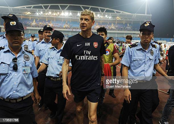 Arsenal manager Arsene Wenger after a training session in Hanoi for the club's preseason Asian tour at the My Dinh National Stadium on July 16 2013...