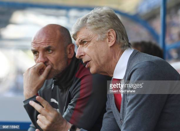 Arsenal manager Arsene Wenger and assistant Steve Bould during the Premier League match between Huddersfield Town and Arsenal at John Smith's Stadium...