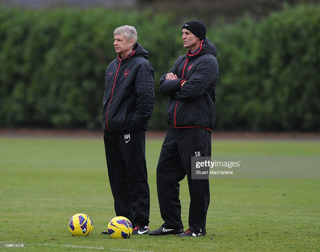 Arsenal manager Arsene Wenger and asssistant Steve Bould during a training session at London Colney on December 21, 2012 in St Albans, England.