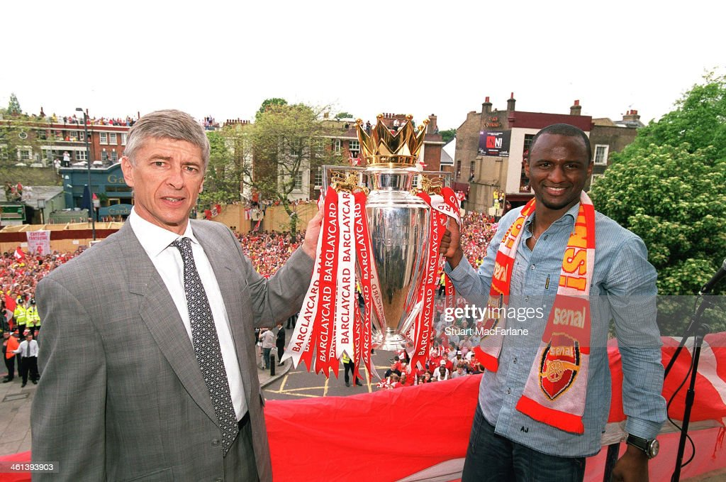 Arsenal manager Arsene Wenger and captain Patrick Vieira hold the Premier League trophy at Islington Town Hall on May 19, 2004 in London, England.