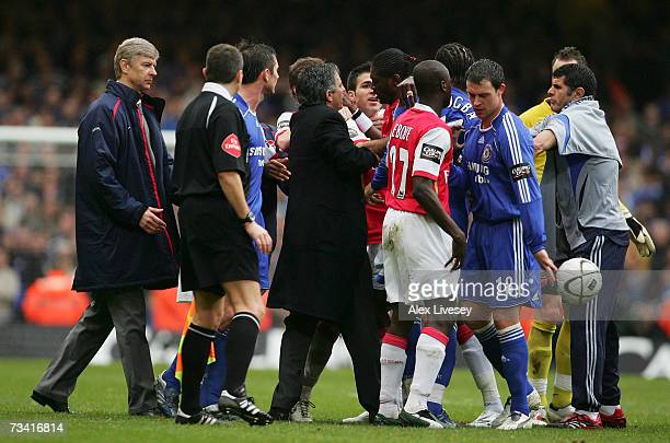 Arsenal Manager Arsene Wenger and Chelsea Manager Jose Mourinho come on to the pitch to try and calm the players down during the Carling Cup Final...