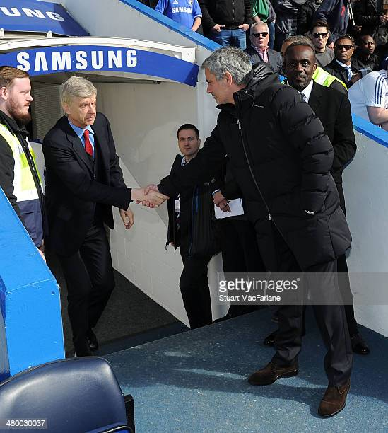 Arsenal manager Arsene Wenger and Chelsea manager Jose Mourinho shake hands before the Barclays Premier League match between Chelsea and Arsenal at...