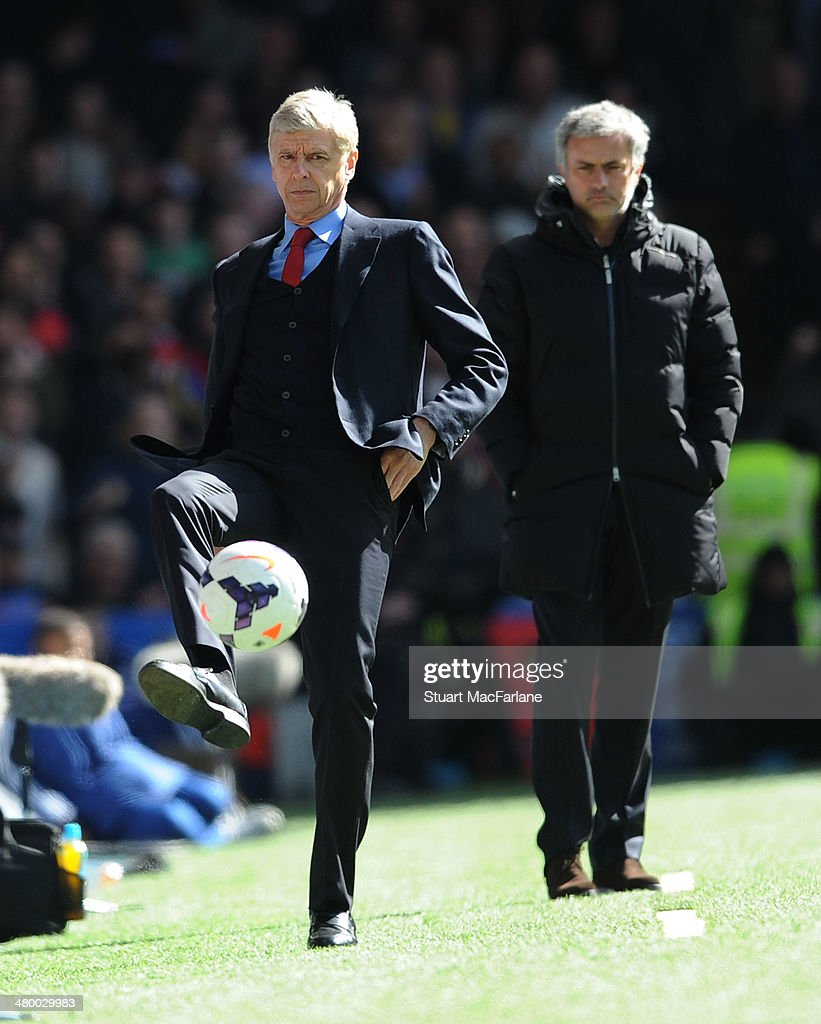 Arsenal manager Arsene Wenger and Chelsea manager Jose Mourinho during the Barclays Premier League match between Chelsea and Arsenal at Stamford Bridge on March 22, 2014 in London, England.