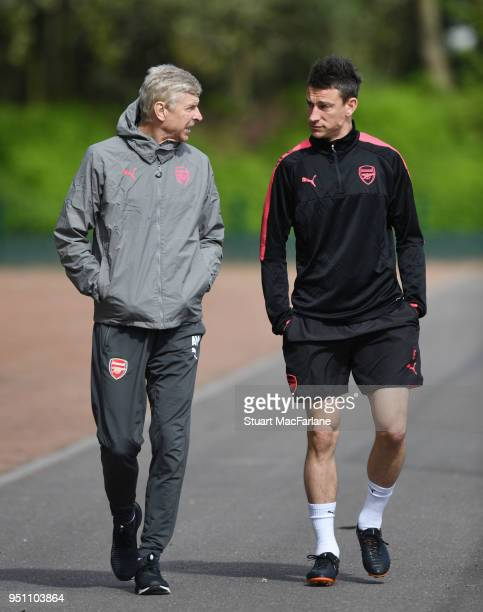Arsenal manager Arsene Wenger and defender Laurent Koscielny before a training session at London Colney on April 25 2018 in St Albans England