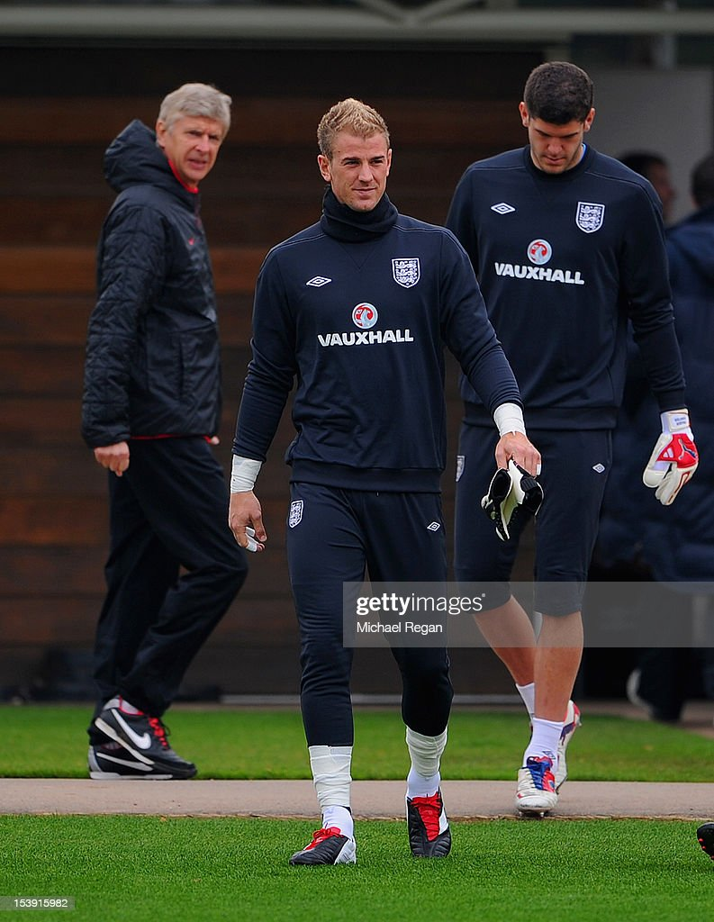 Arsenal manager Arsene Wenger and Joe Hart of England look on during the England training session ahead of their FIFA World Cup qualifier against San Marino at London Colney on October 11, 2012 in St Albans, England.