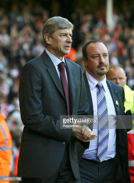 Arsenal manager Arsene Wenger and Liverpool manager Rafael Benitez during the Barclays Premier League match between Liverpool and Arsenal at Anfield...