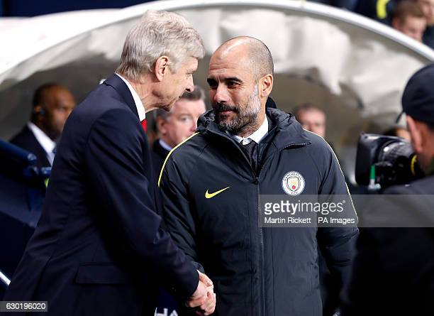 Arsenal manager Arsene Wenger and Manchester City manager Pep Guardiola shake hands before the Premier League match at the Etihad Stadium Manchester