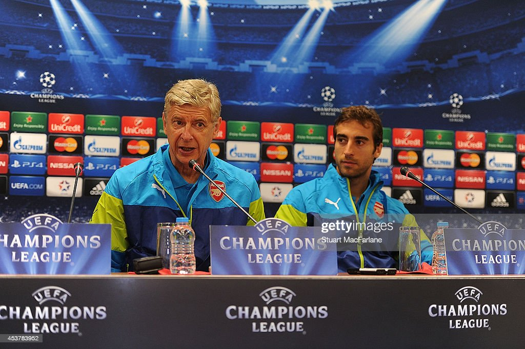 Arsenal manager Arsene Wenger and midfielder Mathieu Flamini attend a press conference at the Ataturk Olympic Stadium on August 18, 2014 in Istanbul, Turkey.
