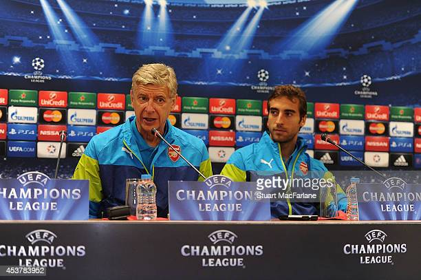 Arsenal manager Arsene Wenger and midfielder Mathieu Flamini attend a press conference at the Ataturk Olympic Stadium on August 18 2014 in Istanbul...