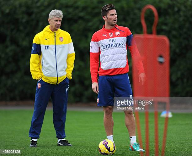 Arsenal manager Arsene Wenger and Olivier Giroud during a training session at London Colney on November 13, 2014 in St Albans, England.