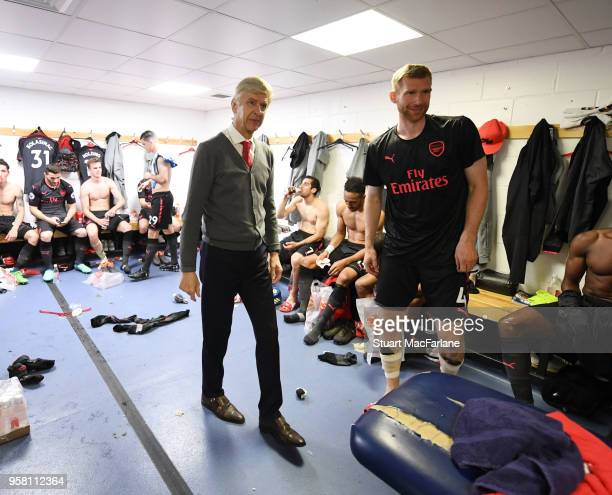 Arsenal manager Arsene Wenger and Per Mertesacker in the changing room after the Premier League match between Huddersfield Town and Arsenal at John...
