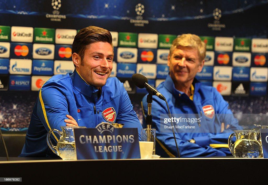 Arsenal manager Arsene Wenger and striker Olivier Giroud attend a pre match press conference at Signal Iduna Park on November 5, 2013 in Dortmund, North Rhine-Westphalia.