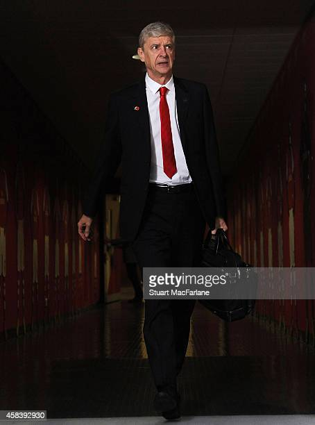 Arsenal manager Arsene Wenger arrives at the home team changing room before the UEFA Champions League Group D match between Arsenal and Anderlecht at...