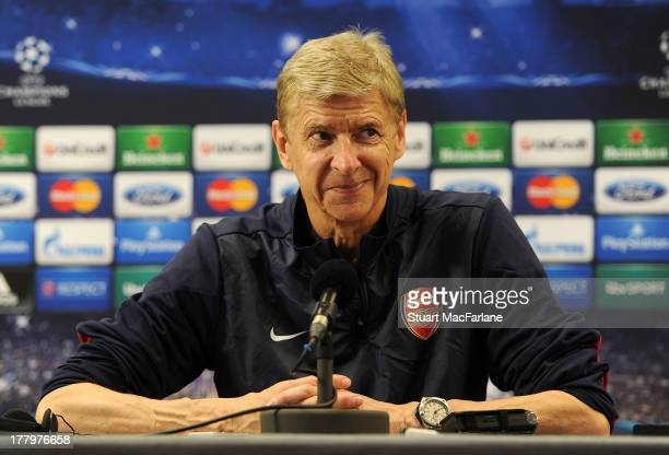 Arsenal manager Arsene Wenger attends a press conference ahead of their UEFA Champions League Play Off second leg match against Fenerbache at London...