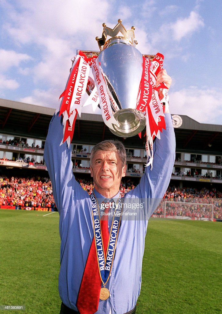 Arsenal manager Arsene Wenger celebrates after winning the Premier League, Arsenal Stadium, Highbury on May 15, 2004 in London, England.