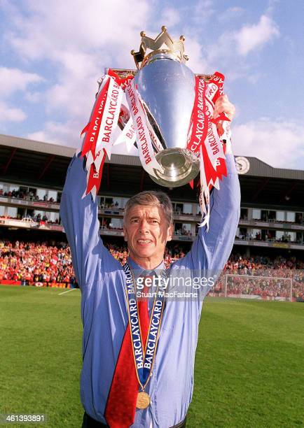 Arsenal manager Arsene Wenger celebrates after winning the Premier League Arsenal Stadium Highbury on May 15 2004 in London England