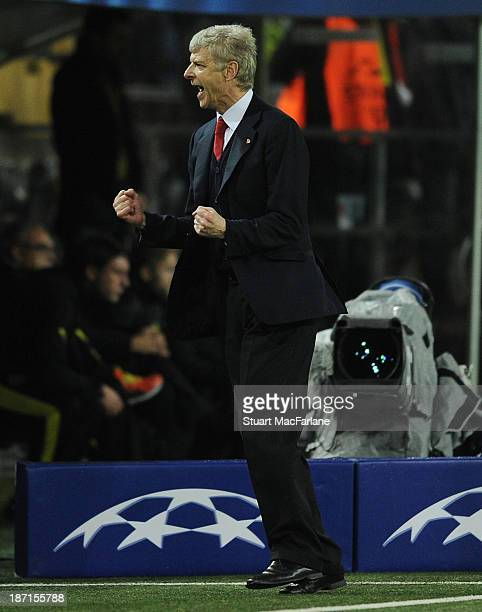 Arsenal manager Arsene Wenger celebrates at the end of the UEFA Champions League Group F match between Borussia Dortmund and Arsenal at Signal Iduna...