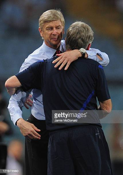 Arsenal manager Arsene Wenger celebrates victory during the UEFA Champions League play-off second leg match between Udinese Calcio and Arsenal FC at...
