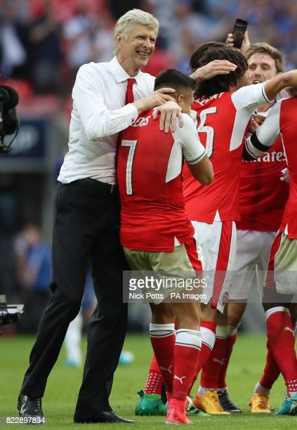 Arsenal manager Arsene Wenger celebrates with Alexis Sanchez