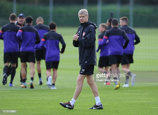 Arsenal manager Arsene Wenger during a training session at London Colney on September 14, 2012 in St Albans, England.