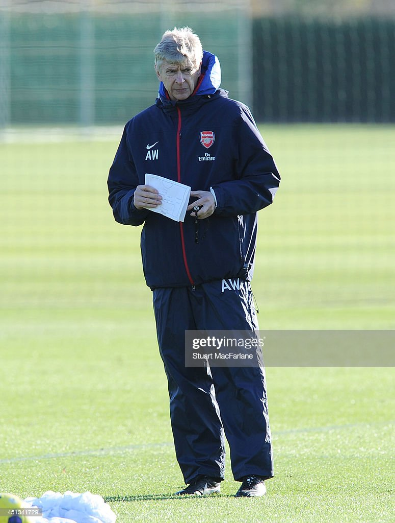 Arsenal manager Arsene Wenger during a training session at London Colney on November 22, 2013 in St Albans, England.