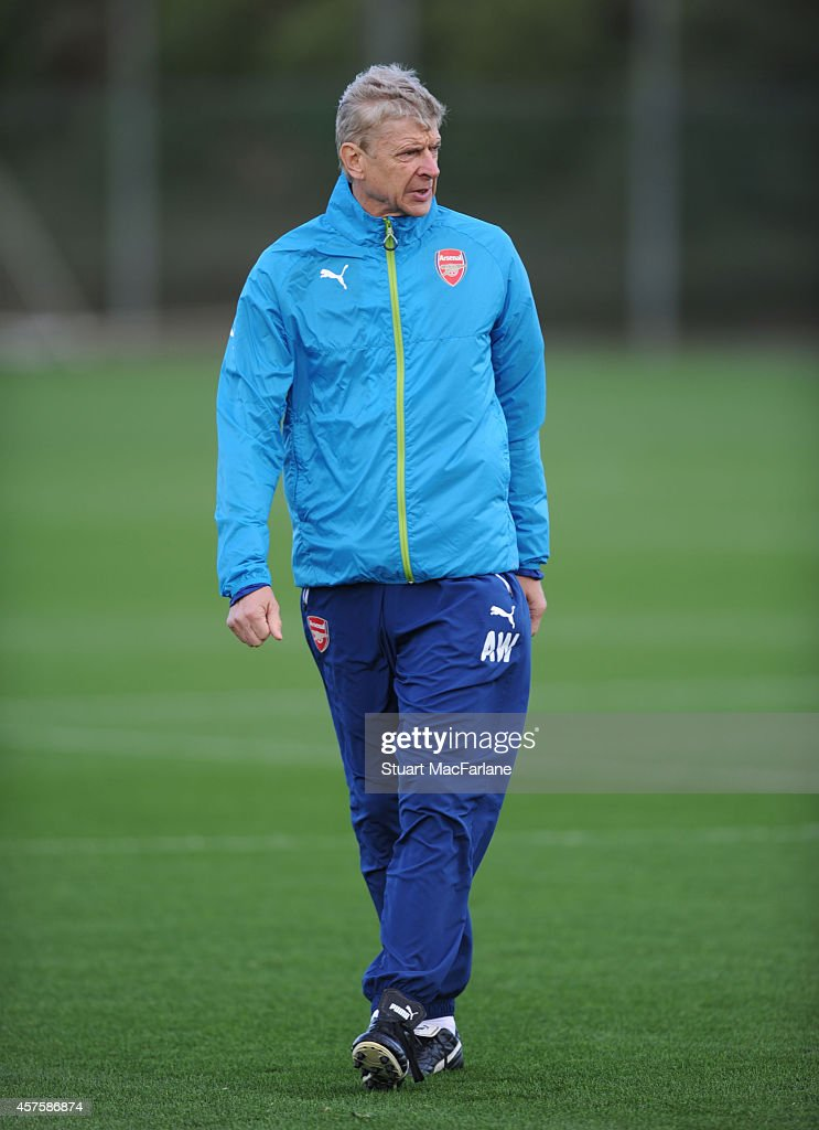Arsenal manager Arsene Wenger during a training session at London Colney on October 21, 2014 in St Albans, England.