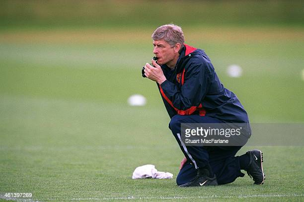 Arsenal manager Arsene Wenger during a training session at London Colney on April 15 2003 in St Albans England