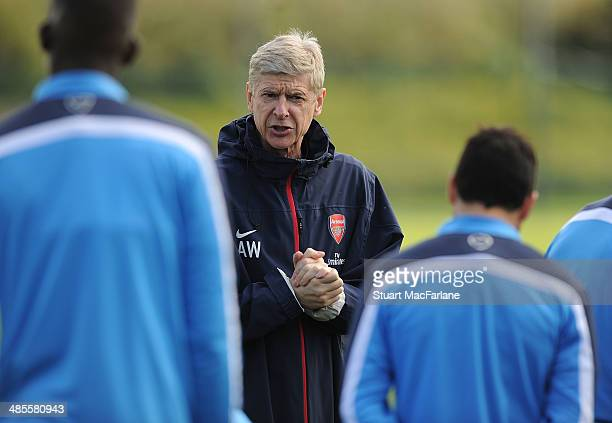 Arsenal manager Arsene Wenger during a training session at London Colney on April 19, 2014 in St Albans, England.
