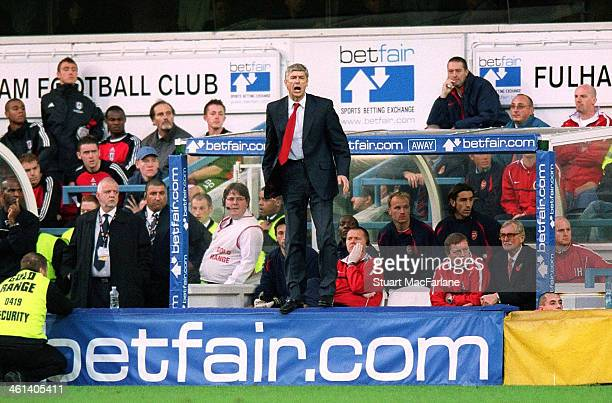 Arsenal manager Arsene Wenger during the match between Fulham and Arsenal at Loftus Road on November 3 2002 in London England