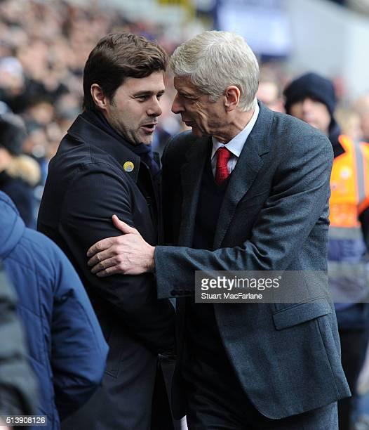 Arsenal manager Arsene Wenger embraces Tottenham mangager Mauricio Pochettino before the Barclays Premier League match between Tottenham Hotspur and...