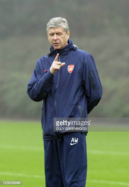 Arsenal manager Arsene Wenger gives instructions during a team training session, at the club's training facility London Colney, near St. Albans,...