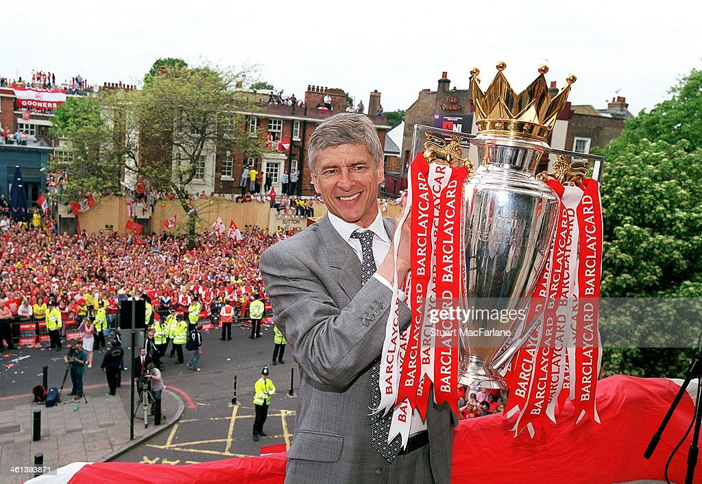 Arsenal manager Arsene Wenger holds the Premier League trophy at Islington Town Hall on May 19, 2004 in London, England.
