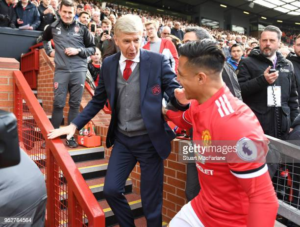 Arsenal manager Arsene Wenger hugs ex player Alexis Sanchez before the Premier League match between Manchester United and Arsenal at Old Trafford on...