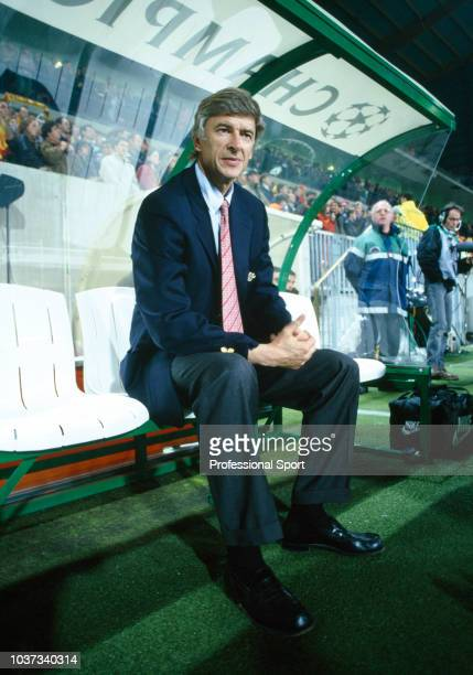 Arsenal manager Arsene Wenger in the dugout before the UEFA Champions League Group E match between RC Lens and Arsenal at the Stade BollaertDelelis...
