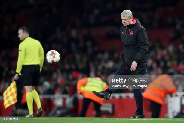 Arsenal manager Arsene Wenger kicks the ball during the UEFA Europa League round of 32 second leg match at the Emirates Stadium London
